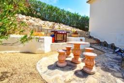 Терраса. Испания, Кальпе : - Двухэтажная вилла для отдыха в Бенитачеле, недалеко от пляжа, супермаркета и ресторанов. 3 спальни, 2 ванные, барбекю