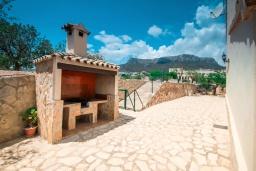 Летняя кухня. Испания, Кальпе : Впечатляющая вилла для семейного отдыха всего в нескольких минутах ходьбы от пляжа Кальпе, 7 спален, 5 ванных комнат, парковка на 5 машин, бассейн