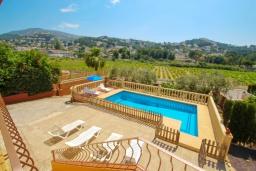Вид на виллу/дом снаружи. Испания, Мораира : Очаровательная вилла, расположенная в сельской местности на окраине Морайры с видом на традиционные виноградники, 3 спальни, 2 ванные комнаты, WIFI