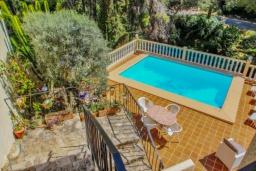 Патио. Испания, Бенисса : Замечательный дом для отдыха, с хорошей мебелью, расположен на вершине холма, 2 спальни, ванная комната, частный басейн
