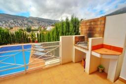 Терраса. Испания, Кальпе : Отличная вилла расположенная в тихом спокойном районе, недалеко от пляжа, частный бассейн, 3 спальни, 1 ванная комната, панорамный вид