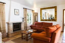 Гостиная / Столовая. Испания, Кала-д'Ор : Просторная уютная вилла  для отдыха на испанском острове Майорка, и может вместить до 6 человек с 3 спальнями, 2 ванными комнатами и собственным бассейном