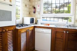 Кухня. Испания, Кала-д'Ор : Просторная уютная вилла  для отдыха на испанском острове Майорка, и может вместить до 6 человек с 3 спальнями, 2 ванными комнатами и собственным бассейном