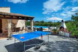 Развлечения и отдых на вилле. Испания, Польенса : Уютная вилла, расположенная между городом Полленса и пляжем Пуэрто-Полленса, с зеленым садом, бассейном, большой террасой и открытой обеденной зоной, 3 спальни, 2 ванные комнаты, мини-кухня, Wi-Fi.