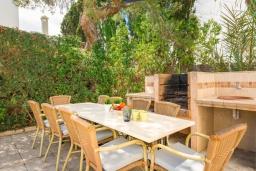 Зона барбекю / Мангал. Испания, Кала-д'Ор : Красивая вилла с садом и частным бассейном, и вместимостью до 10 человек с 5 спальнями, 3 ванными комнатами