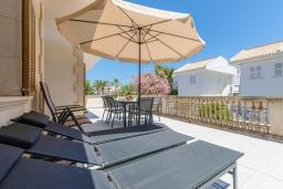 Терраса. Испания, Кан-Пикафорт : Просторное шале для 8 человек недалеко от пляжа