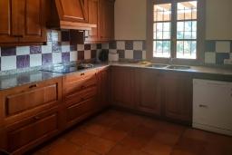 Кухня. Испания, Алькудия : Солнечная вилла с красивым видом, с 3 спальнями, 2 ванными комнатами, частным бассейном, кондиционерами и Wi-Fi