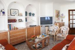 Гостиная / Столовая. Испания, Порто Колом : Очаровательная трехэтажная вилла с видом на море и пляж, с 4 спальнями, 4 ванными комнатами и собственным бассейном.