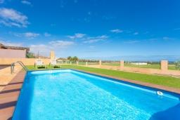 Бассейн. Испания, Фуэртевентура : Одноэтажная вилла с частным бассейном и обеденной зоной на открытом воздухе, с 3 спальнями, 3 ванными комнатами и видом на море.
