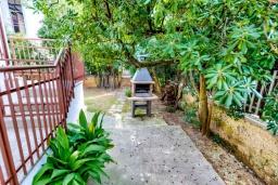 Зона барбекю / Мангал. Испания, Алькудия : Очаровательная озеленена вилла с современным интерьером, с 4 спальнями и 3 ванными комнатами.