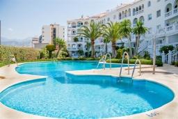Испания, Нерха : Очаровательный трехкомнатный таунхаус для 6 человек в Нерхе, в 10 метрах от песчаного пляжа PLAYA TORRECILLA и в 15 минутах ходьбы от смотровой площадки с панорамным видом Балкон Европы, 2 спальни, 2 ванные комнаты, общий и детский бассейны, Wi-Fi.