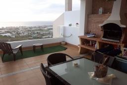 Терраса. Испания, Торрокс : Роскошный двухэтажный дом для отдыха с бассейном и видом на море и горы в Торроксе, 3 спальни, 3 ванные комнаты, Wi-Fi.