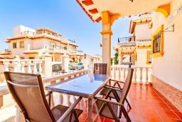 Терраса. Испания, Ориуэла  : Изящный таунхаус со всеми удобствами, расположенный в Ориуэле, недалеко от пляжа Кабо Роиг, 2 спальни, 2 ванные комнаты и терраса на крыше, оборудован кондиционерами по всему дому