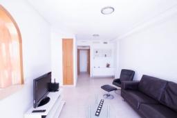Гостиная / Столовая. Испания, Мучамель : Светлая и просторная квартира расположена в паре минут езды от прекрасного города Мучамель, 3 спальни, 1 ванная комната, терраса на крыше с видом на море