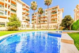 Вид на виллу/дом снаружи. Испания, Альбир : Стильная светлая квартира в многоквартирном доме с лифтом, идеально расположена в центре Альбира и всего в 200 метрах от пляжа, 2 спальнями, 2 ванными комнатами и общим бассейном.