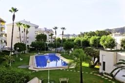 Территория. Испания, Альбир : Очаровательная квартира в центре города Альбир, с ярким стильным интерьером, который не оставит вас равнодушным, с 2 спальнями, 2 ванными комнатами и общим бассейном на территории жилого комплекса
