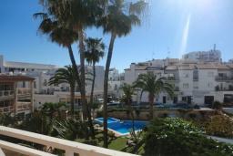 Вид на виллу/дом снаружи. Испания, Нерха : Замечательные апартаменты с видом на цветущий сад, бассейном и солнечной террасой в Нерхе, в 100 метрах от песчаного пляжа PLAYA CARABEO, 3 спальни, 2 ванные комнаты, центральное отопление, бесплатный Wi-Fi.