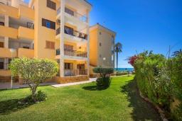 Вид на виллу/дом снаружи. Испания, Плайя Фламенка : Очаровательная 2х комнатная квартира, недалеко от пляжа, и всех местных удобств