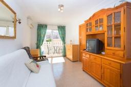 Гостиная / Столовая. Испания, Торревьеха : Красивые апартаменты расположенные менее чем в 400 метрах от популярного пляжа в Торревьехе, с 1 спальней и 1 ванной комнатой