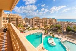Вид. Испания, Торревьеха : Просторная квартира с 2 спальнями и 2 ванными комнатами, всего в 500 метрах от потрясающих белых песчаных пляжей.