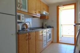 Кухня. Испания, Кальпе : Квартира с видом на море и общими бассейнами, в непосредственной близости от пляжа в Кальпе, с 2 спальнями и 2 ванными комнатами